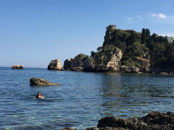 Having a swim near Isola Bella, Taormina, Sicily family holiday italy