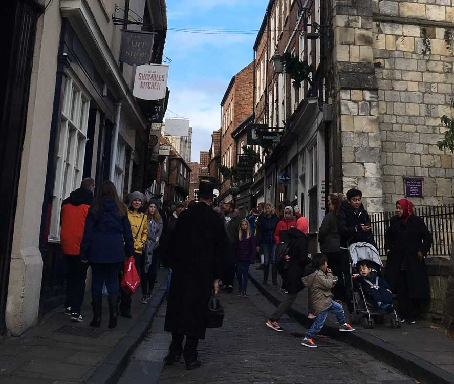 people shopping in the Shambles, York
