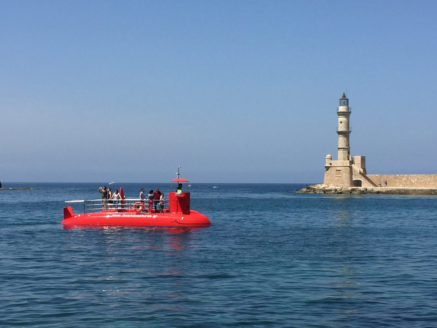 Our red submarine passing Chania's lighthouse