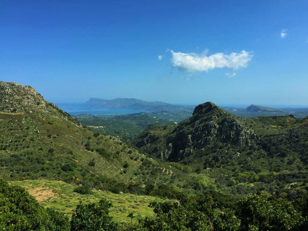 Green hills and mountains with sea in distance, Crete Greece