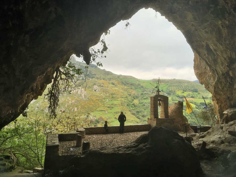 People looking out of the cave entrance at Agia Sofia in western Crete