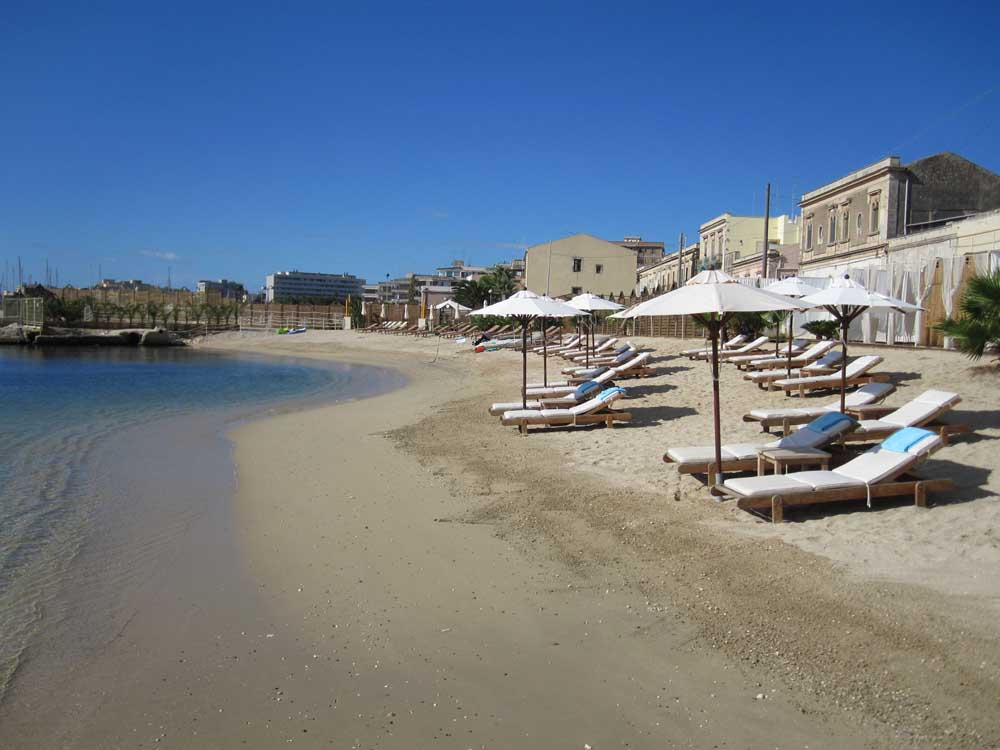 Beach umbrellas in eastern Sicily, best beaches of Sicily