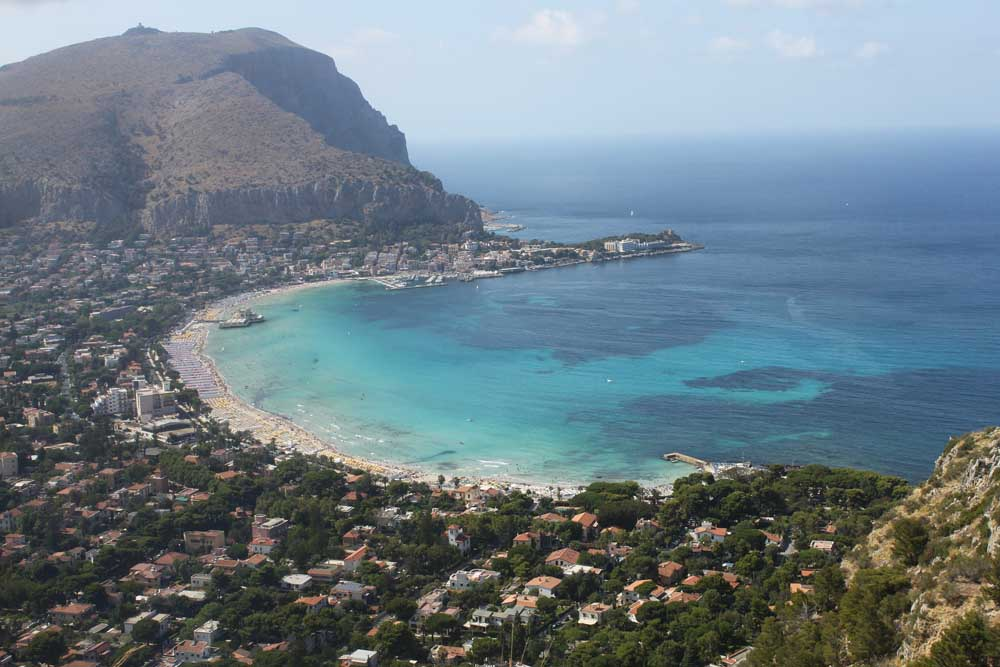 Mondello curved beach sicily with turquoise sea and mountains