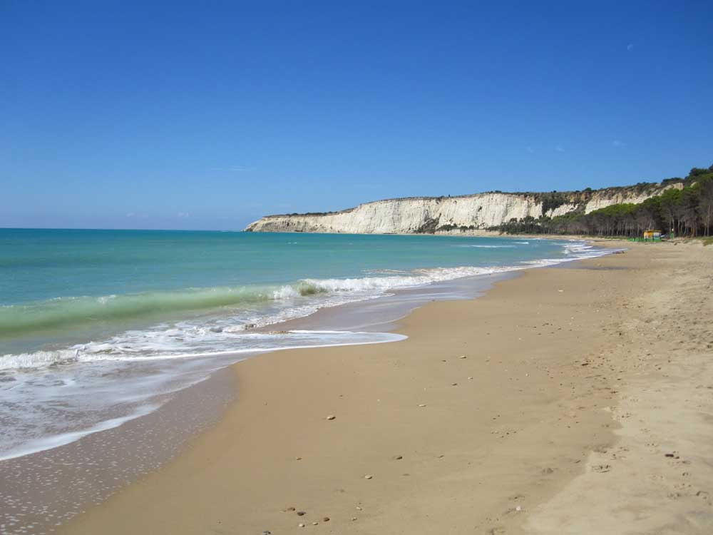 sandy beach with white cliffs in southern sicily