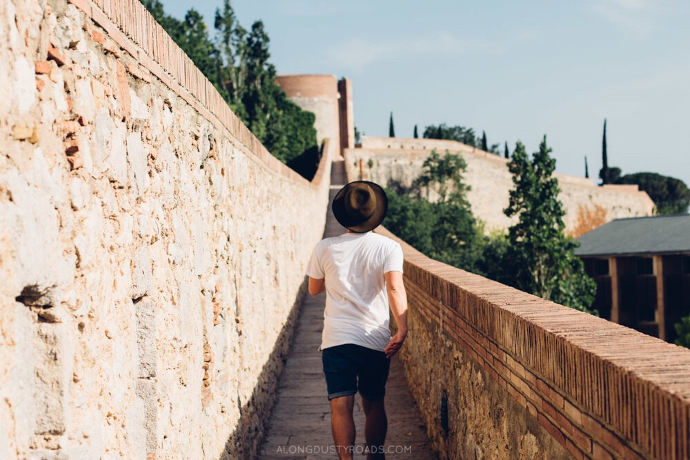 Walking along Girona city walls, family city break