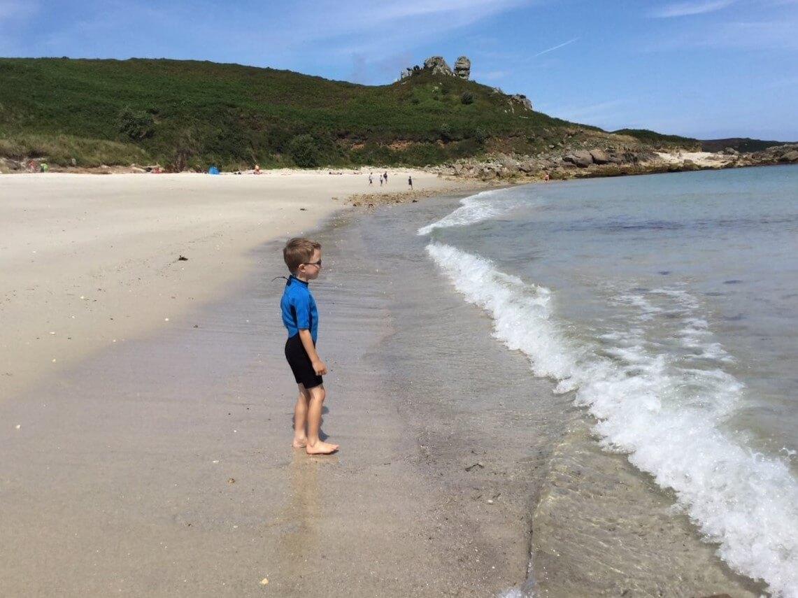 Boy on beach Scilly Isles