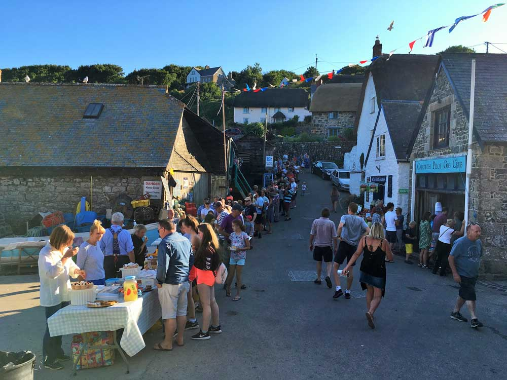 people queuing at Cadgwith Cove on BBQ night in summertime, Cornwall
