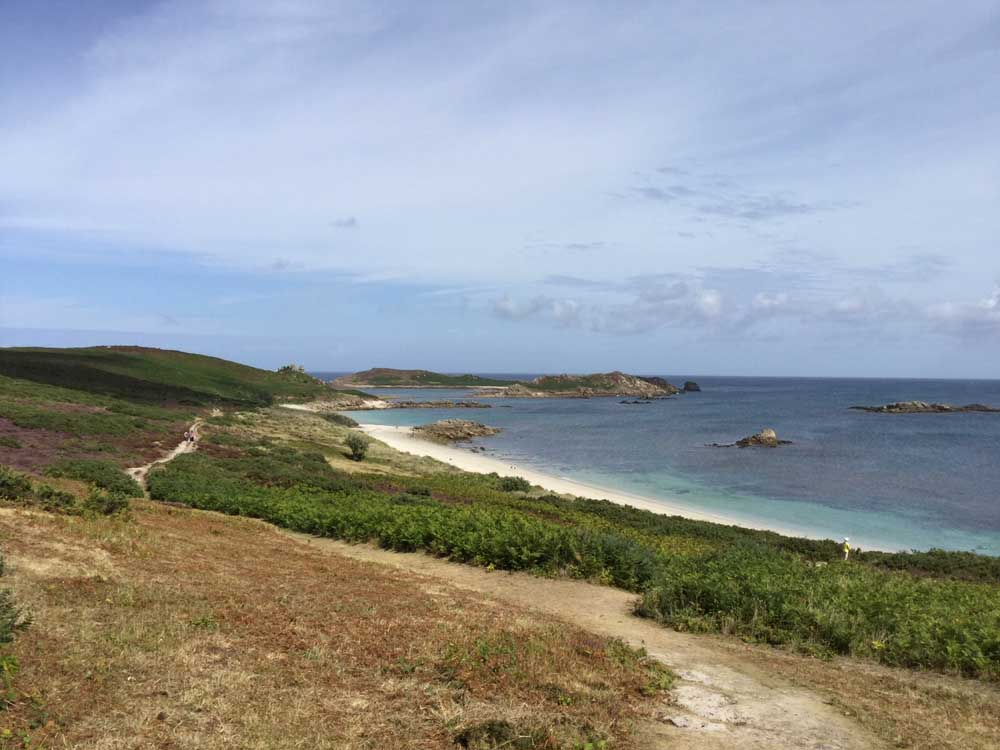 scilly isles beach with heathland and sandy beach