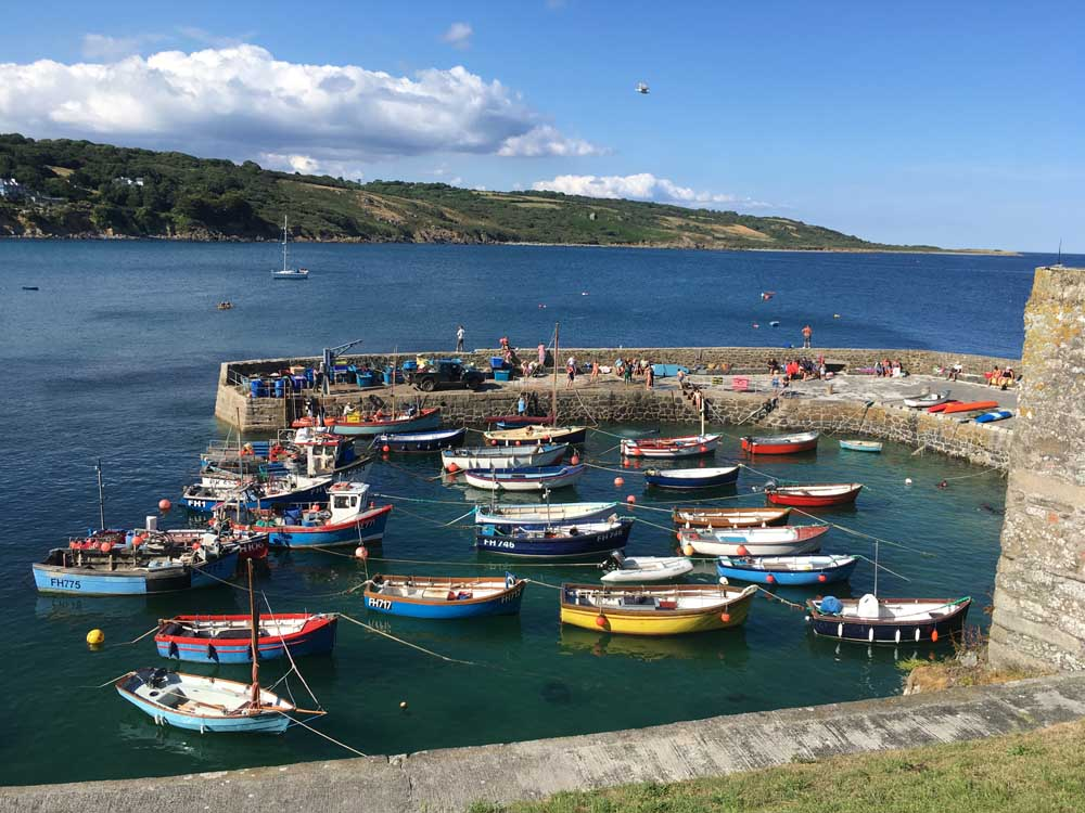 colourful fishing boats in walled harbour Coverack Lizard Peninsula Cornwall