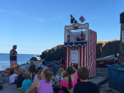 Punch and Judy at Cadgwith Cove Lizard Peninsula Cornwall