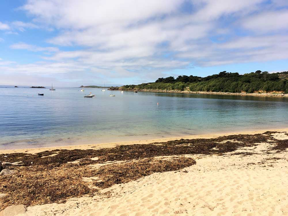 beach with seaweed on the sand, isles of scilly