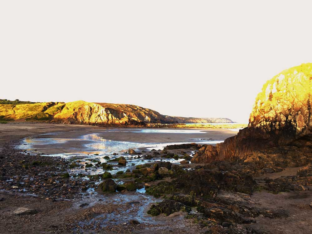 Sunset at Kennack Sands beach Lizard Peninsula Cornwall