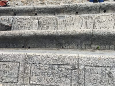 Performance name and dates hand carved into the concrete seats at the Minack Theatre