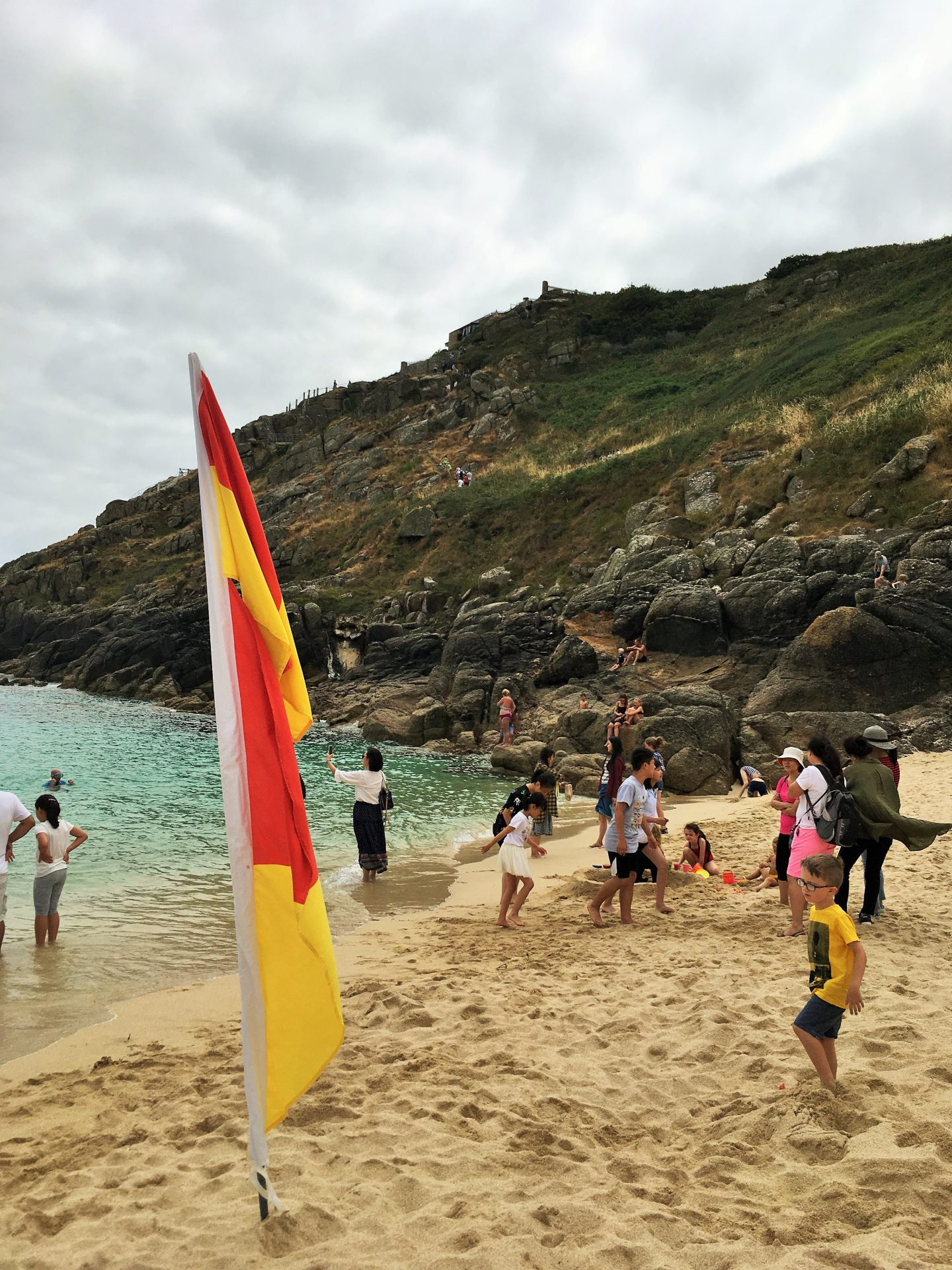 Porthcurno Beach with the steep climb from the Minack Theatre in the background, Cornwall