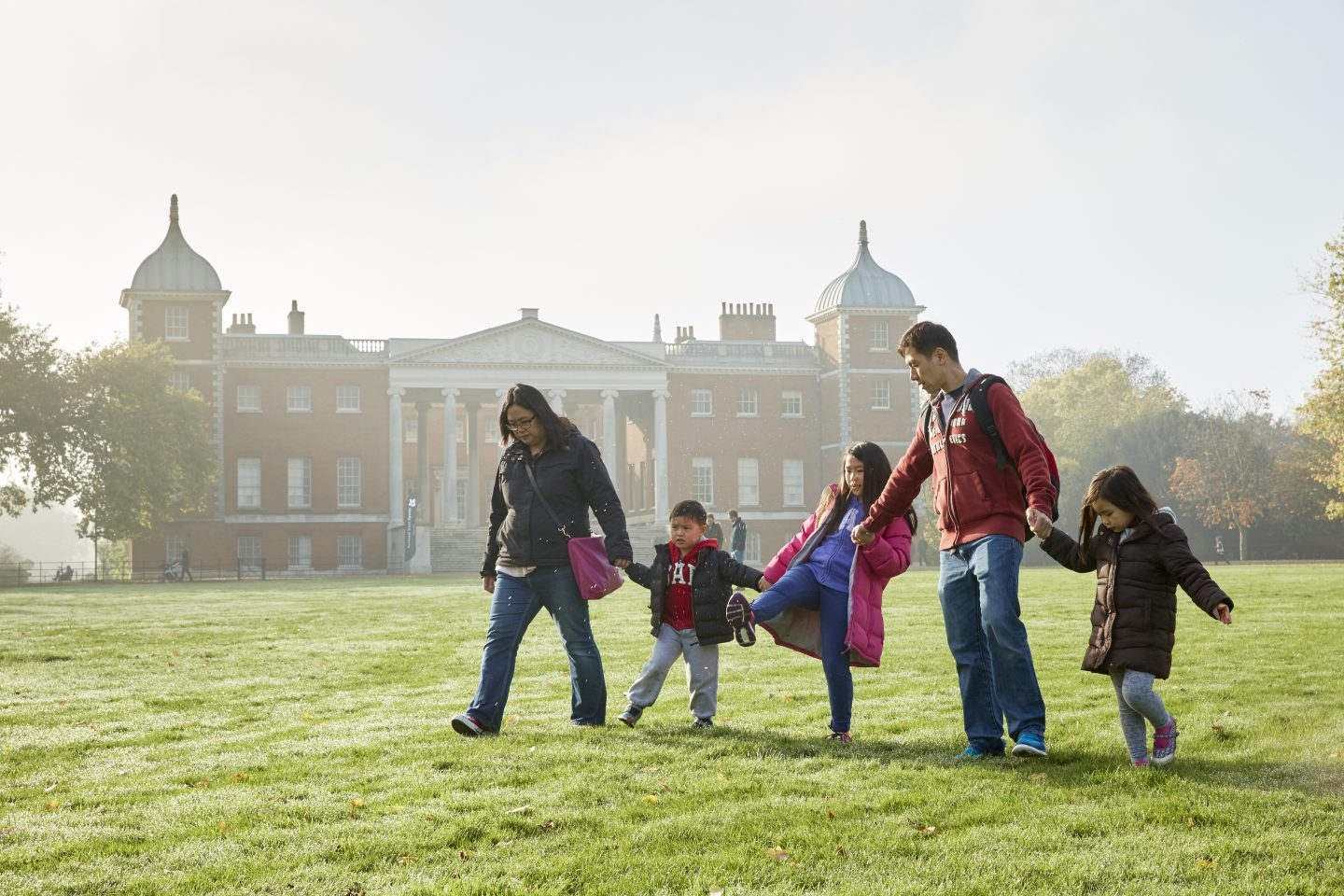 A family walking in the grounds at Osterley Park and House, London. just off the motorway m4