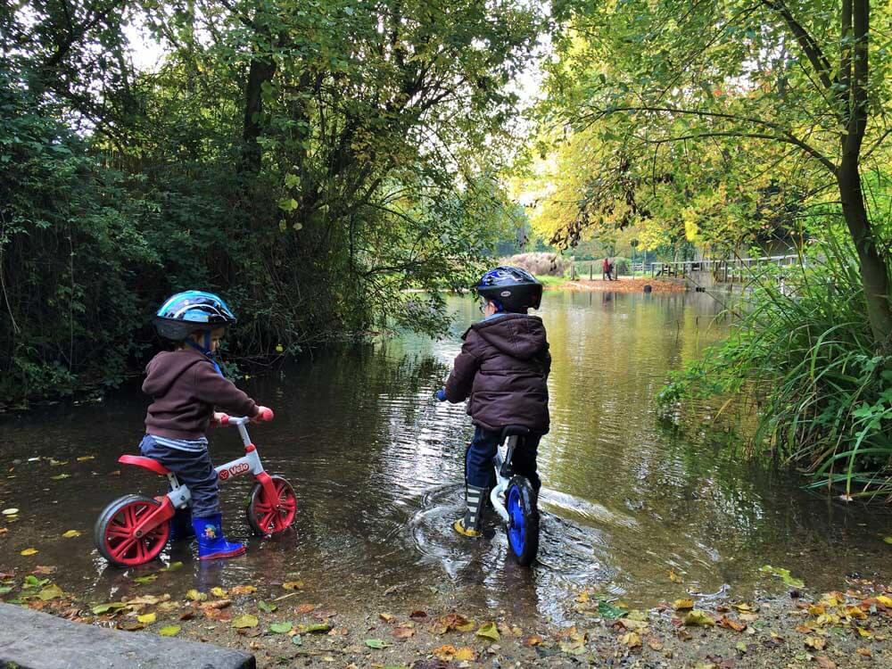 children on bikes at the ford near St John's Castle, Odiham, just off junction 5, M3 motorway