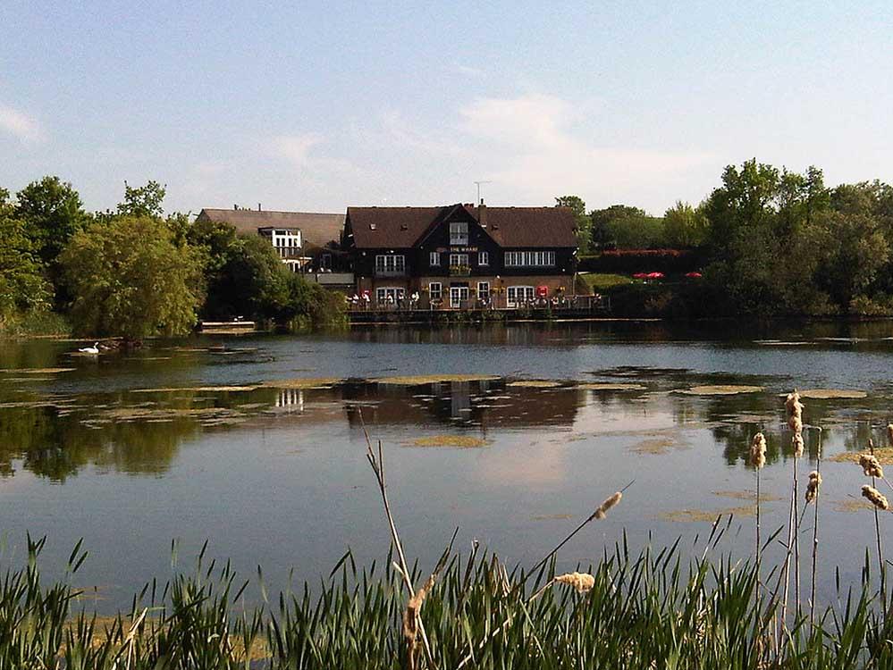 View across Cotton Lake to the wharf pub, credit Wharf pub