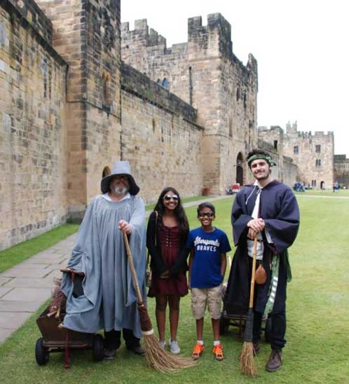 family in front of alnwick castle northumberland weekend break