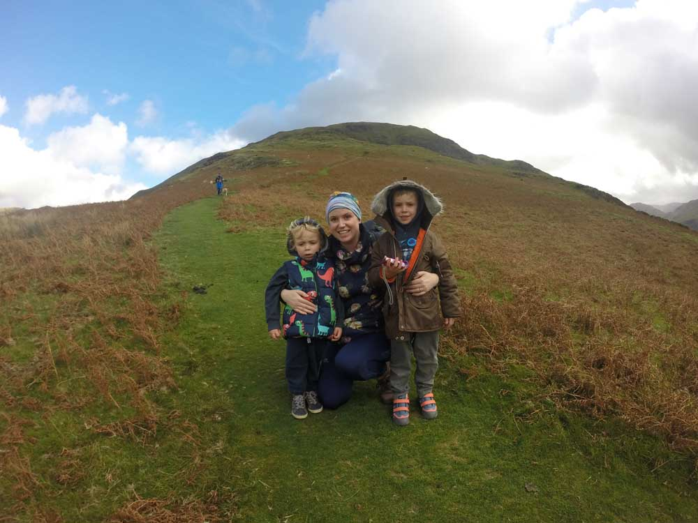family on mountainside Lake District short break, family friendly long weekend, short breaks uk family