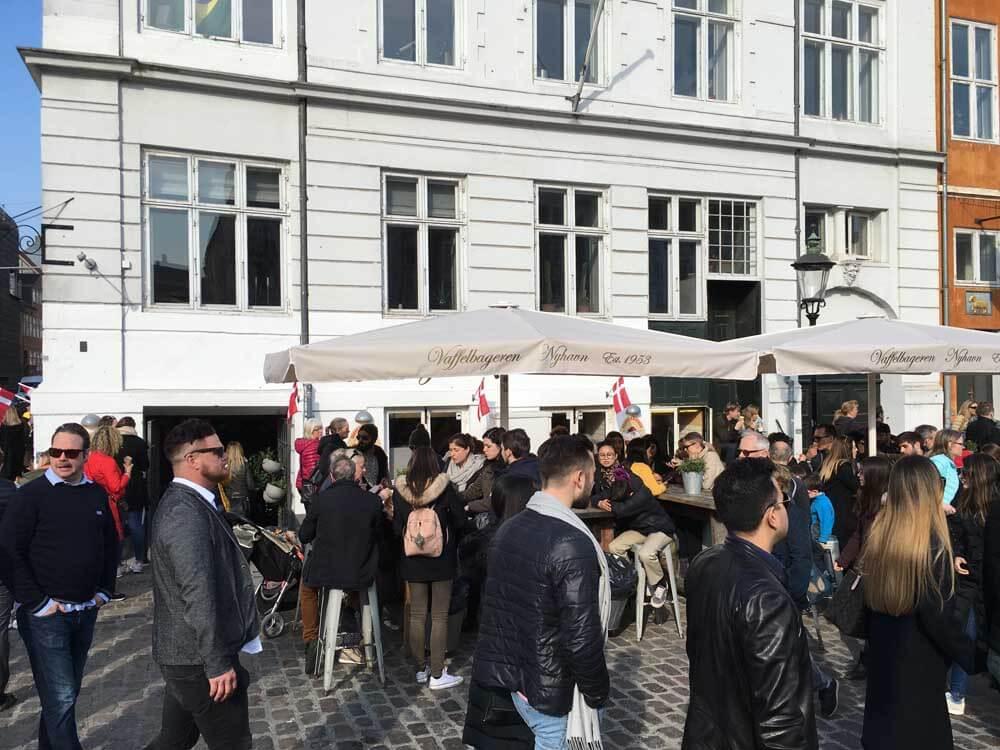 People outside Vaffelbageren, Nyhavn Copenhagen Denmark