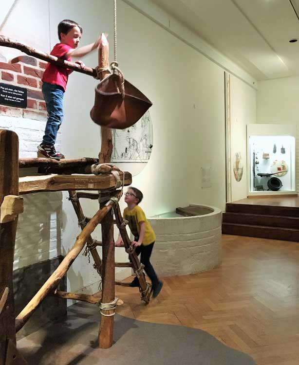 children playing at house building at childrens museum of national museum of denmark copenhagen