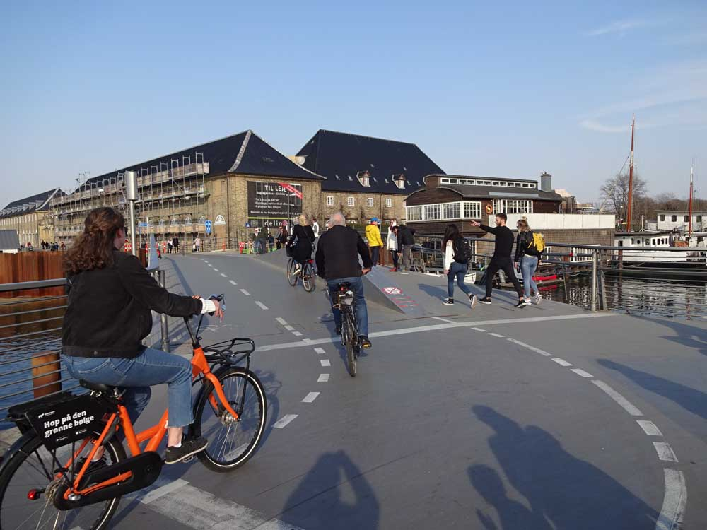 cycling over bridge copenhagen denmark