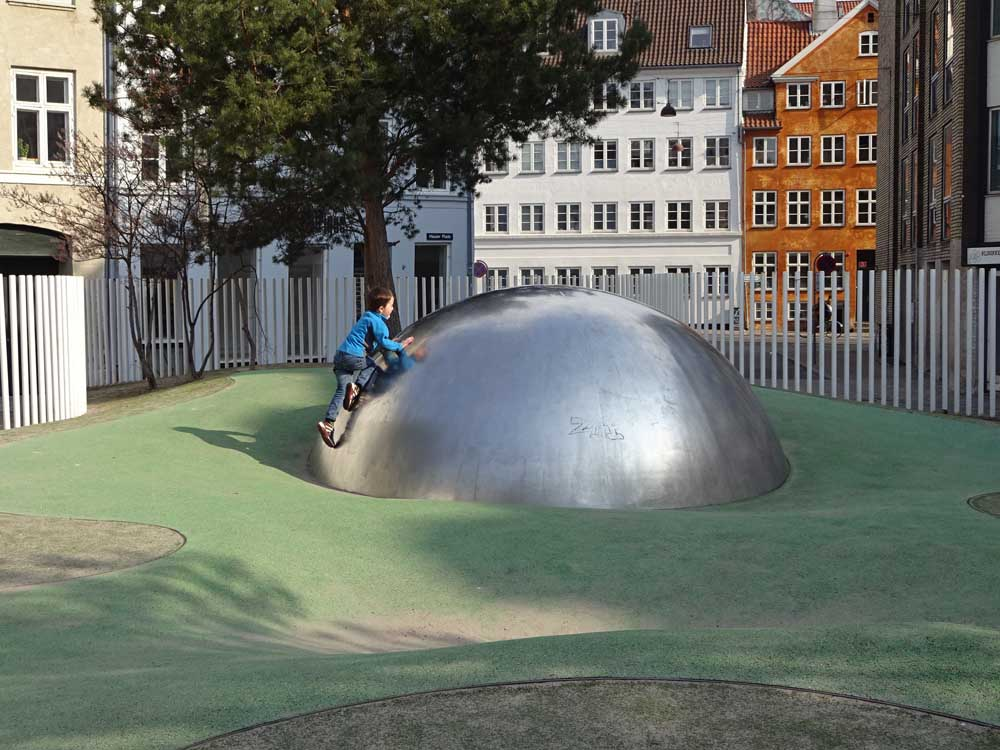 metal domes of Hauser Plads playground in copenhagen with kids