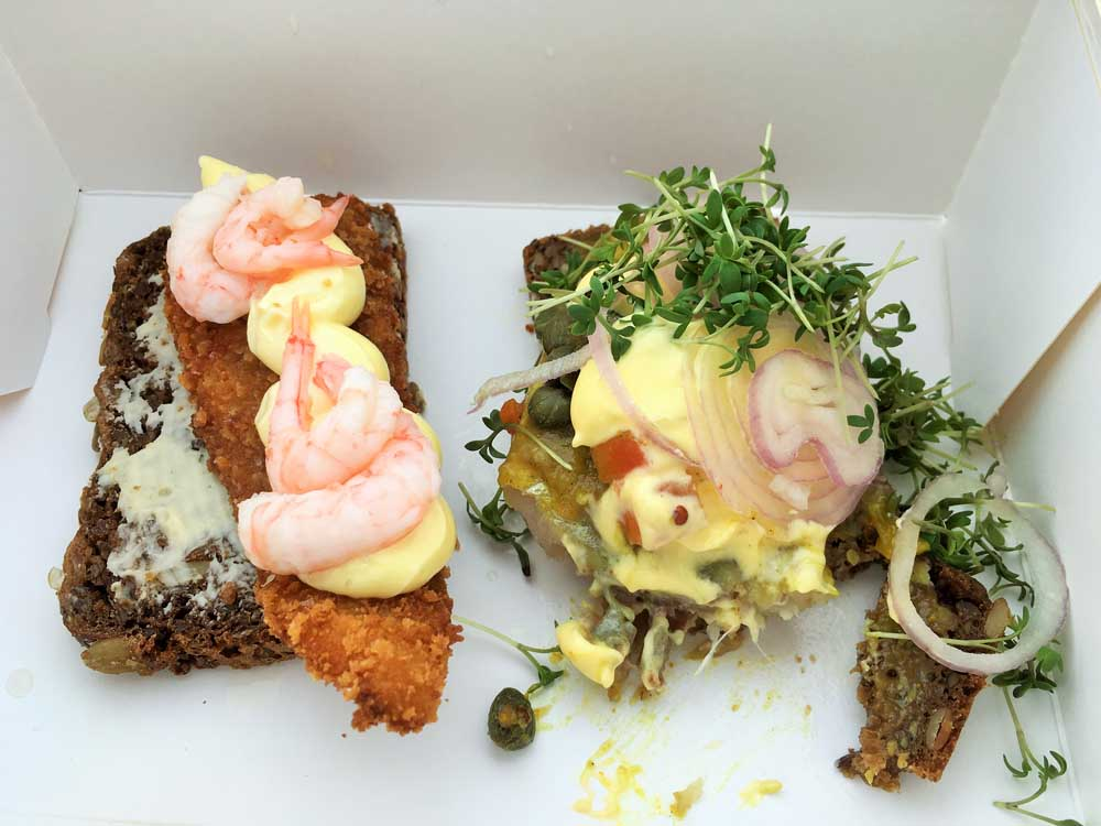 prawns on bread and herring on bread Smørrebrød: the Danish open sandwich