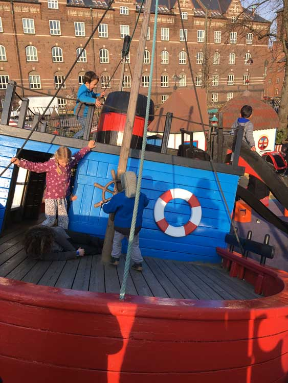 children playing in tivoli gardens playground pirate ship