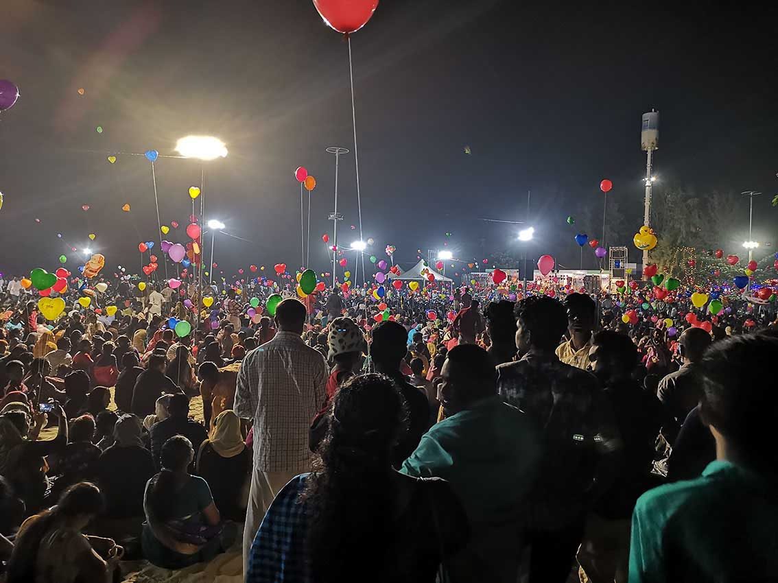 crowds of people and balloons at Alleppey in Kerala on New Year's Eve