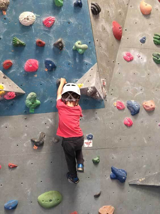 Child on climbing wall