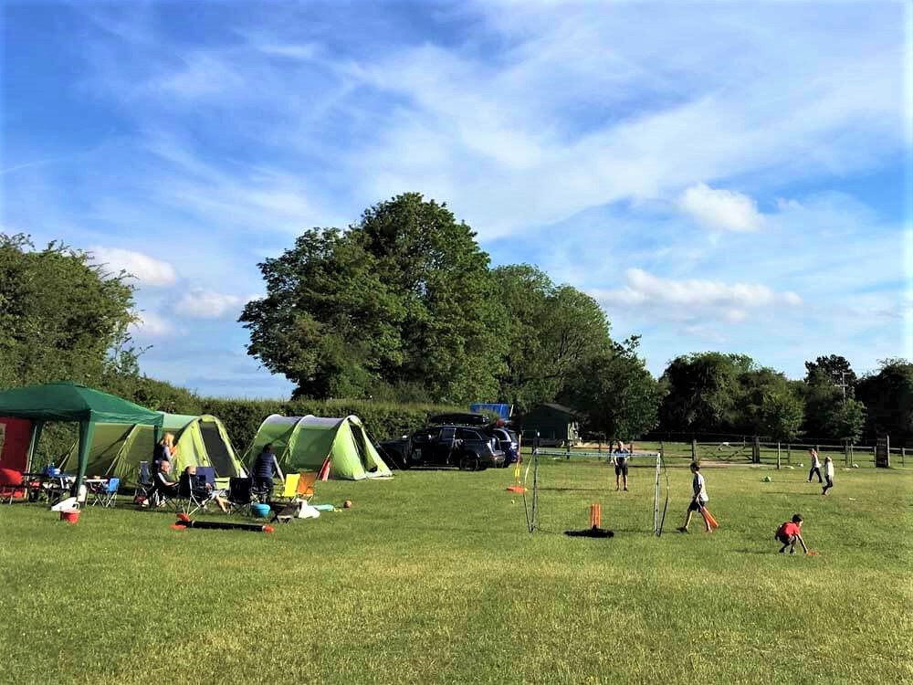 Children playing at campsite in Cotswolds
