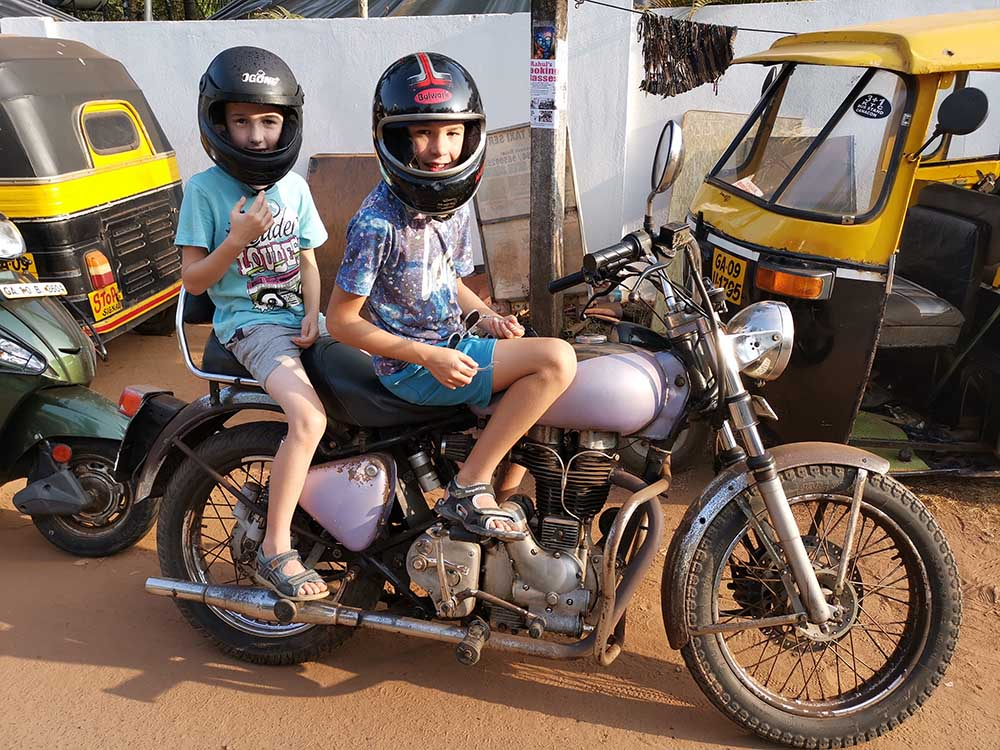 Goa with kids, children on an Enfield motorbike on a family holiday to india