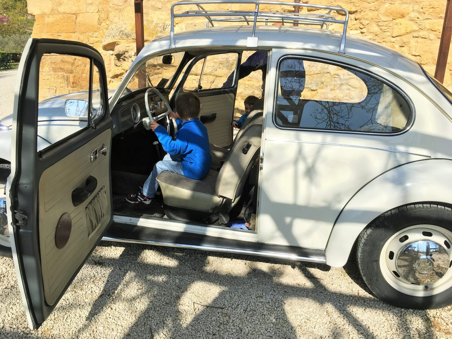 family holiday checklist, white vw beetle bug