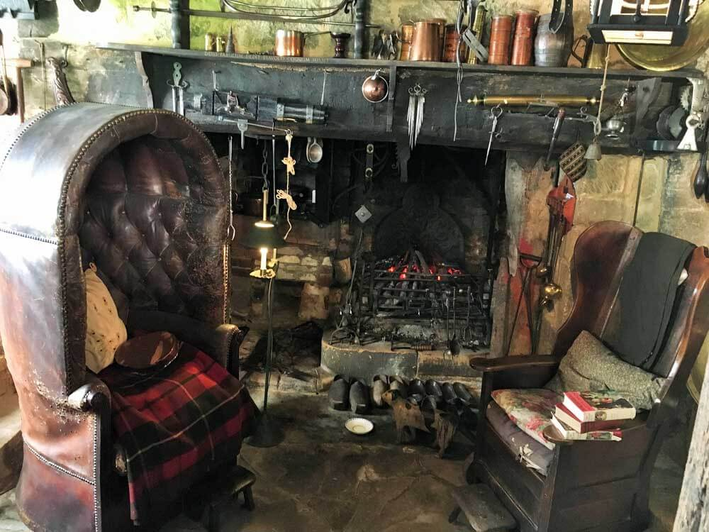 Seats next to fireplace at Snowshill Manor in the Cotswolds