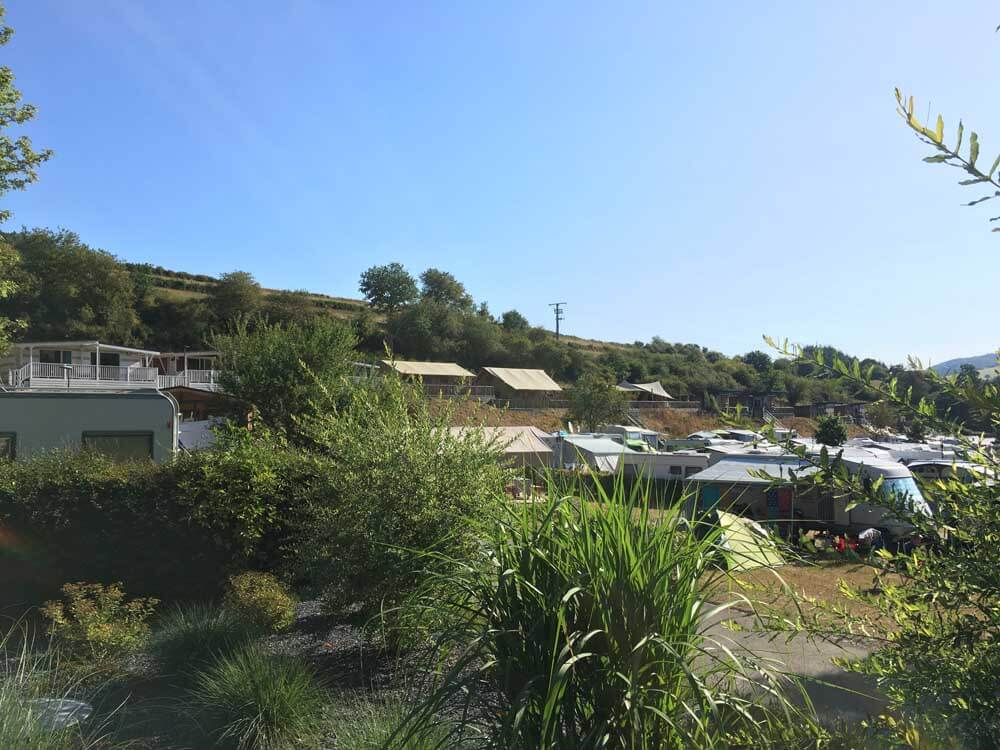 Safari tents overlook the camping pitches at Kaul Camping in Luxembourg