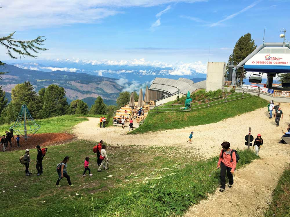 Chairlift, restaurant and play area at Oberholz in the Italian Dolomites