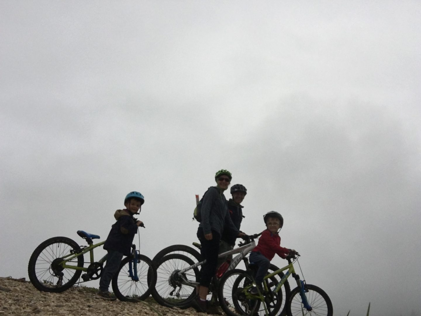 Cycling in the mist, lake karersee, lago d carezza