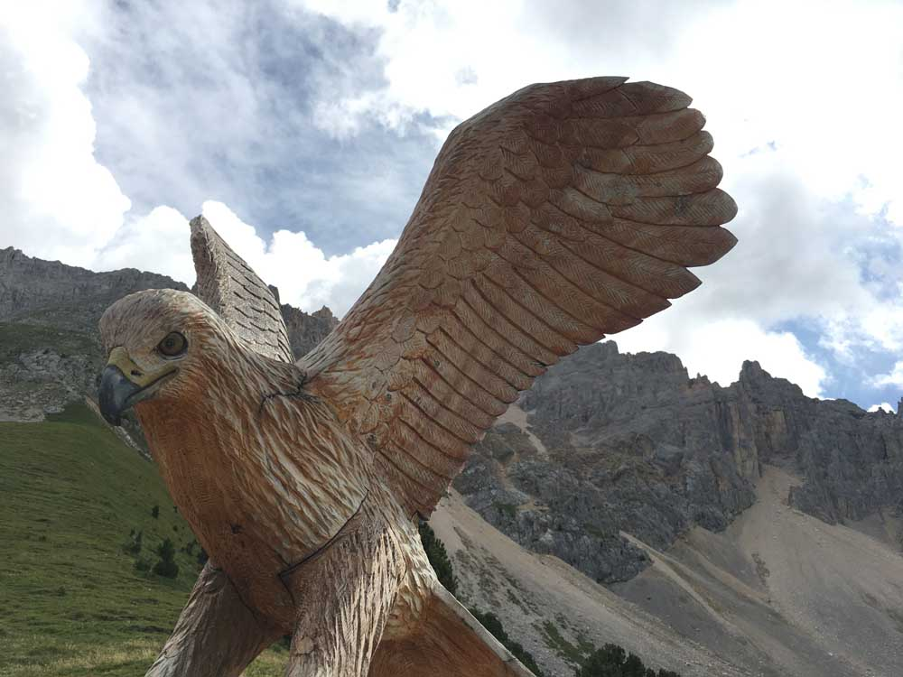sculpture of eagle in the Dolomites mountains italy