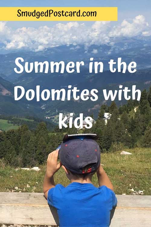 child looking across the dolomites, summer in the dolomites with kids