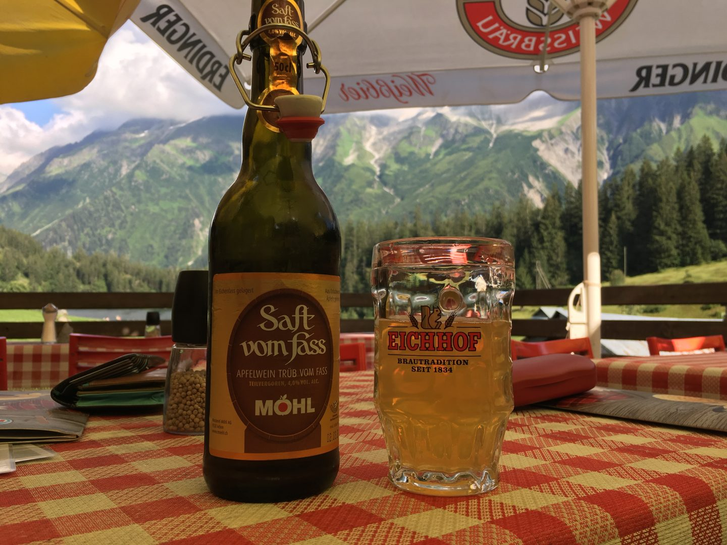 cider in the mountains, terrace with a view in the Swiss Alps