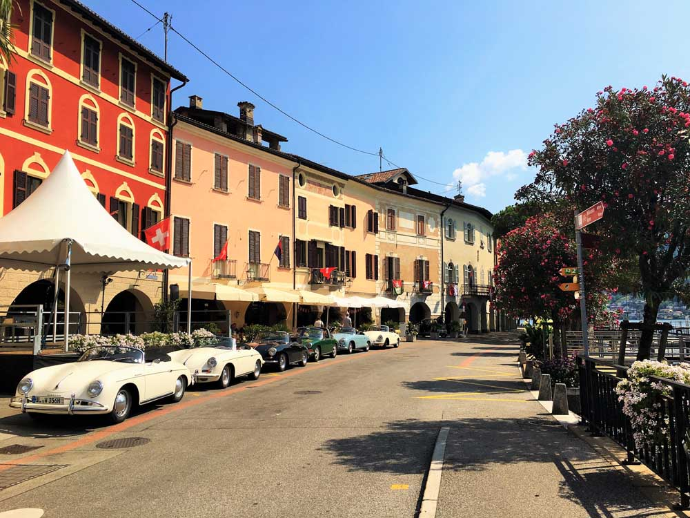 classic cars parked on italian street, European family road trip