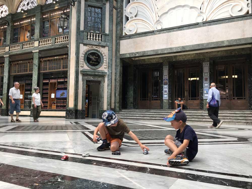 Children in the Galleria San Federico Turin Italy