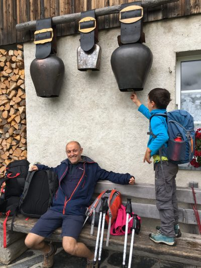 Taking a break at a mountain dairy in Switzerland, family friendly hike