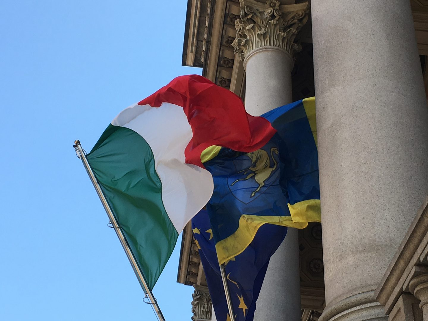 Flags of Turin and Italy on the side of Mole Antonelliana in Turin