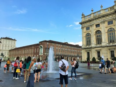 Water fountains in in Piazza Castello, Turin with kids