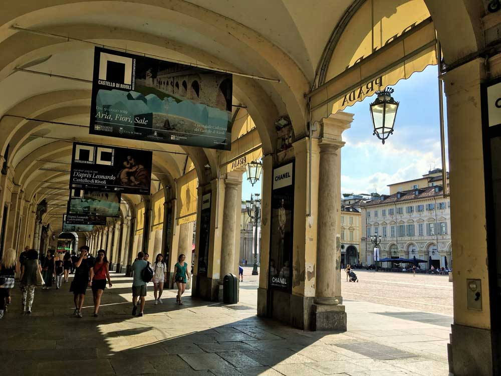 Porticoed walkways in Turin with kids