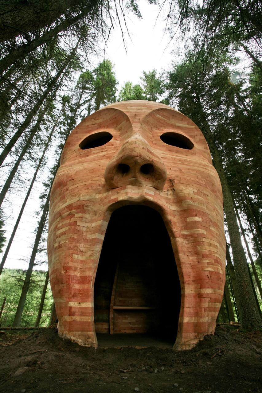 Silvas Capitalis, wooden head in forest at Kielder