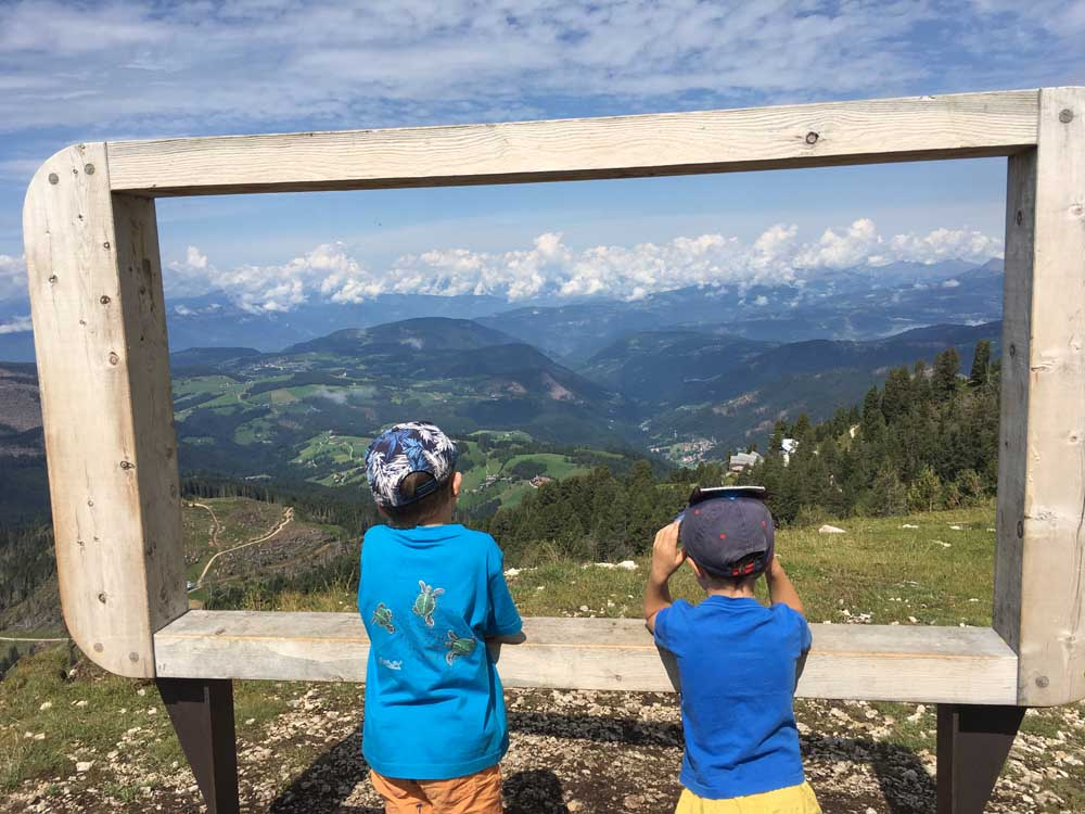 children looking at view of mountains in Dolomites Italy