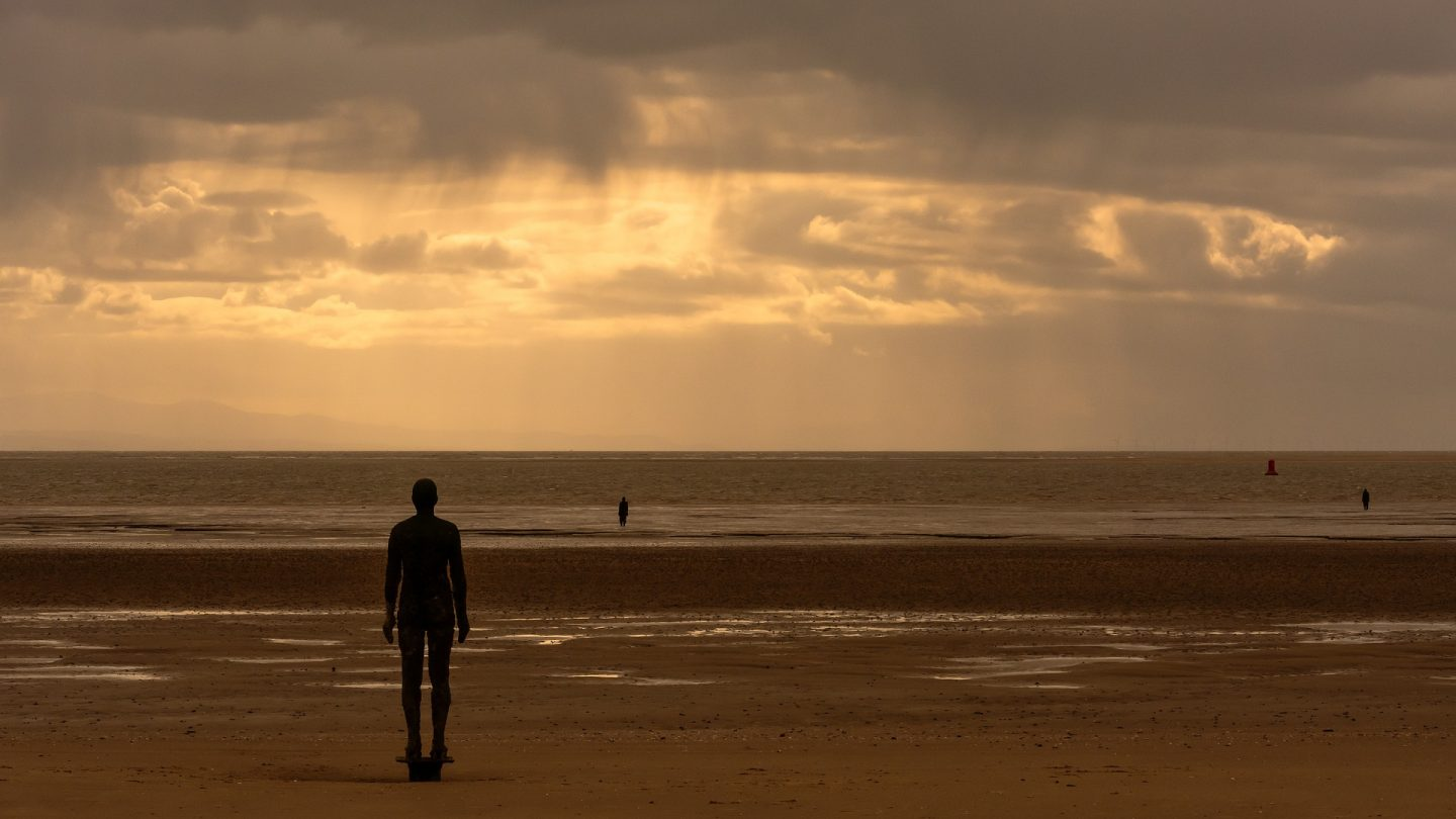 Sculptural figures on a beach, Another Place, Crosby Beach, Mersyside, image by Tim Hill from Pixabay